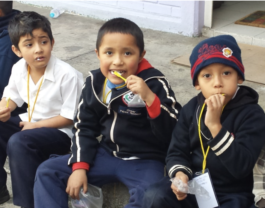 Children in Mexico brushing their teeth